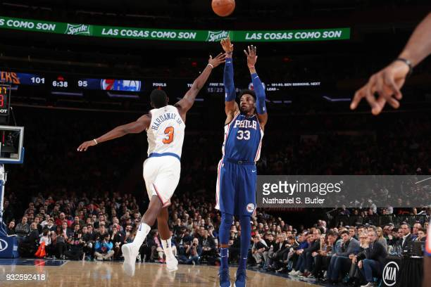 Robert Covington of the Philadelphia 76ers shoots the ball during the game against the New York Knicks on March 15 2018 at Madison Square Garden in...