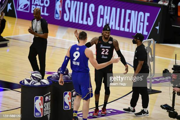 Robert Covington of the Portland Trail Blazers hi-fives Nikola Vucevic of Team Durant during the Taco Bell Skills Challenge as part of 2021 NBA All...