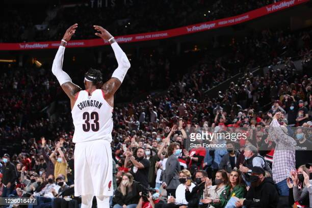 Robert Covington of the Portland Trail Blazers hypes up the crowd during the game against the Sacramento Kings on October 20, 2021 at the Moda Center...