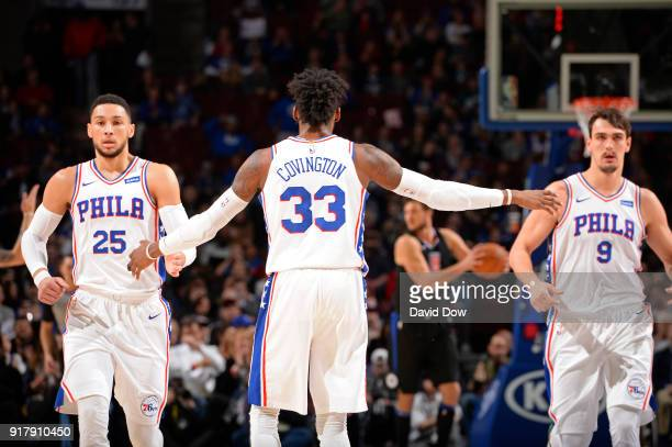 Robert Covington shakes hands with Ben Simmons and Dario Saric of the Philadelphia 76ers during the game against the LA Clippers at Wells Fargo...
