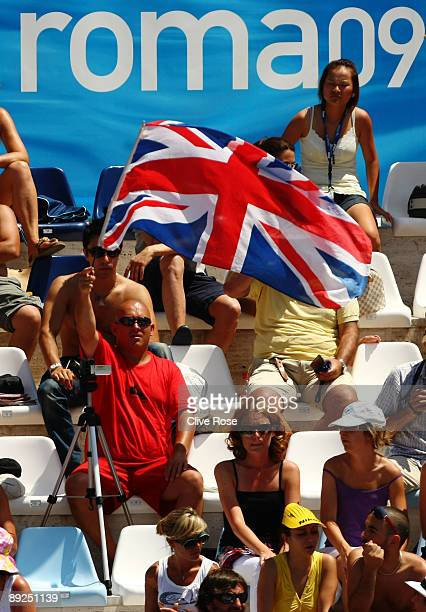 Robert Daley flies the British flag as he supports his son Thomas Daley as he competes in the Men's 10m Synchro Platform Final during the 13th FINA...