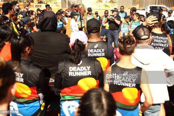 Robert de Castella speaks to competitors in the Mutitjulu community as they prepare to compete in the Uluru Relay Run as part of the National Deadly...