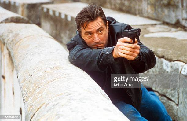 Robert De Niro aiming gun in a scene from the film 'Ronin' 1998