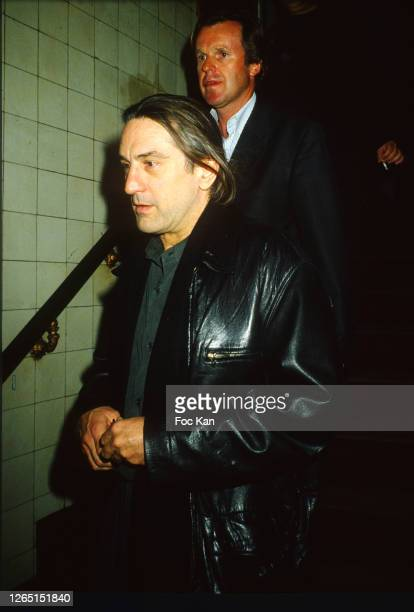 Robert de Niro and a guest attend a Party in Les Bains Douches during A Paris Fashion Weeks in the 1990s in Paris France