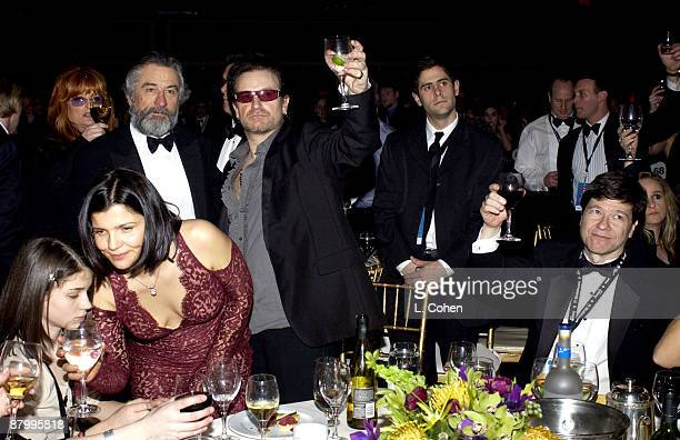 Robert De Niro and Bono with guests