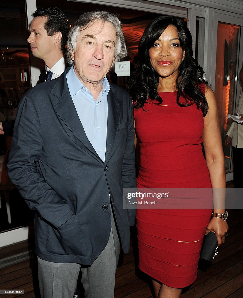 Robert De Niro (L) and Grace Hightower attend the IWC and Finch's Quarterly Review Annual Filmmakers Dinner at Hotel Du Cap-Eden Roc on May 21, 2012 in Antibes, France.