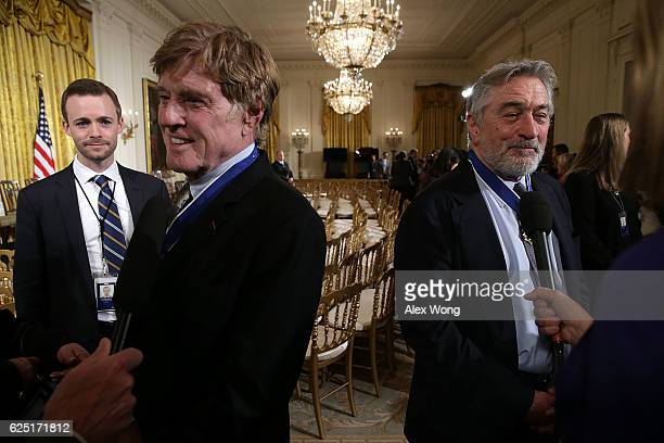 Robert De Niro and Robert Redford speak to members of the media after a Presidential Medal of Freedom presentation ceremony at the East Room of the...