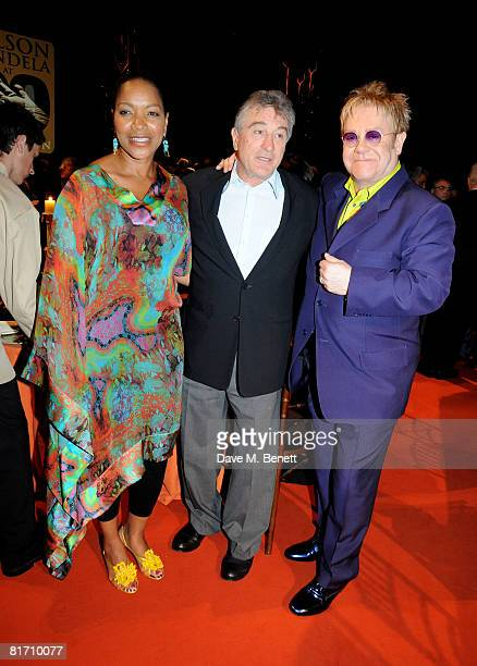 Robert De Niro and wife Grace Hightower with Sir Elton John attend the dinner in honour of Nelson Mandela celebrating his 90th birthday at Hyde Park...