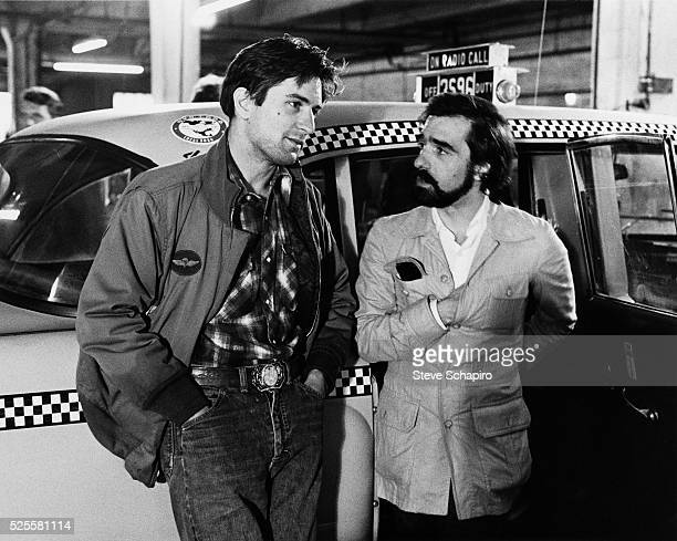 Robert De Niro as Travis Bickle and director Martin Scorsese on the set of Taxi Driver