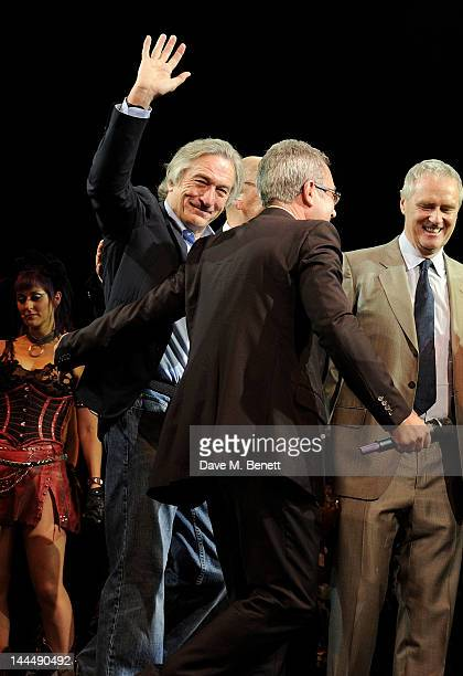 Robert De Niro, Ben Elton and Phil McIntyre bow at the curtain call during the We Will Rock You 10 Year Anniversary Celebration performance at The...