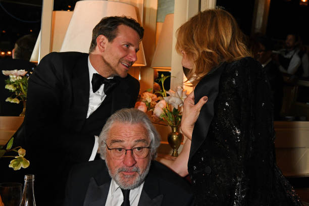 Robert De Niro Bradley Cooper and Laura Dern pose the Netflix BAFTA after party at Chiltern Firehouse on February 2 2020 in London England