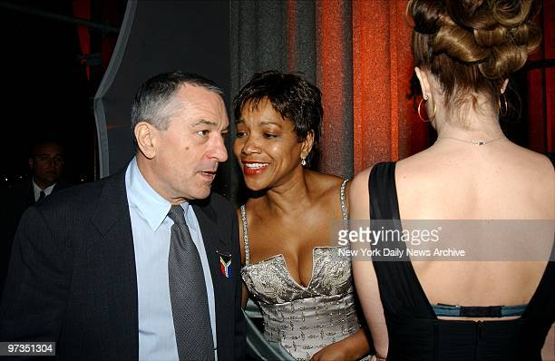 Robert De Niro chats with Grace Hightower at a party celebrating the Tribeca Film Festival at the Manhattan Supreme Court building He cohosted the...