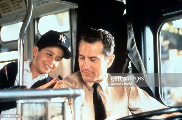 Robert De Niro driving a bus while talking with a young boy in a scene from the film 'A Bronx Tale' 1993