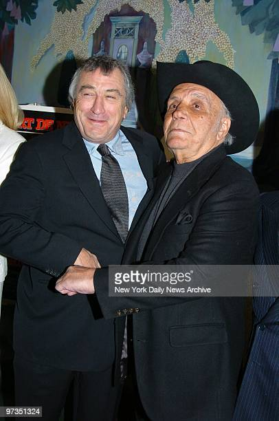 Robert De Niro receives a body blow from former boxing champ Jake LaMotta as they get together at the Ziegfeld Theater for a special screening to...