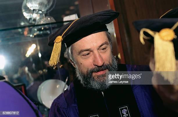 Robert De Niro speaks to fellow graduates at the New York University graduation ceremony De Niro is receiving an honorary doctorate degree in fine...