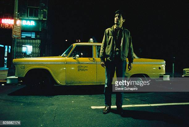 Robert De Niro Stands Beside Cab in Martin Scorsese's Taxi Driver