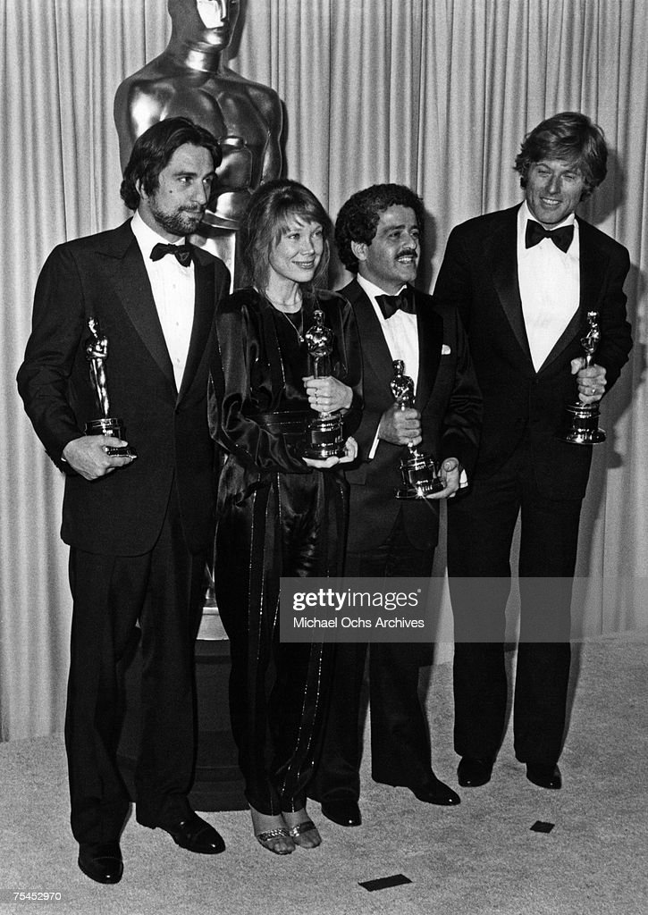 Robert De Niro, winner for Best Actor for Raging Bull, Sissy Spacek, winner for Best Actress for Coal Miner's Daughter, Ronald L. Schwary, winner for Best Picture for Ordinary People, and Robert Redford, winner for Best Dirctor for Ordinary People, proudly brandish their awards at the 53rd Annual Academy Awards on March 31, 1981, in Los Angeles, California.