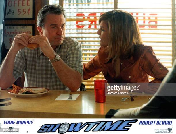 Robert De Niro with woman on lobby card for the film 'Showtime' 2002