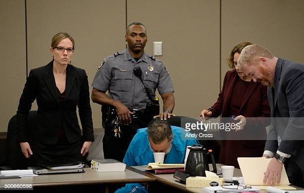 Robert Dear Jr leans his head to get a drink of water from a styrofoam cup at the end of his court appearance on December 09 2015 where El Paso...
