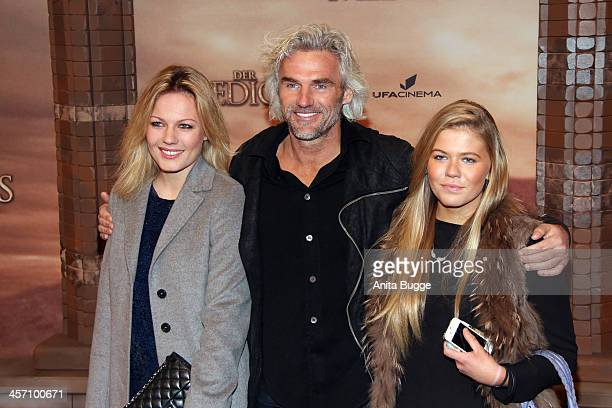 """Robert Dekeyser and daughter Carolin and guest attend the """"The Physician"""" German premiere at Zoo Palast on December 16, 2013 in Berlin, Germany."""