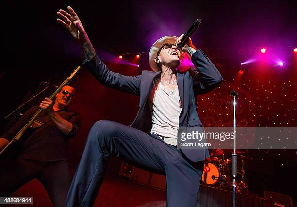 Robert DeLeo and Chester Bennington of Stone Temple Pilots perform at The Fillmore Detroit on September 16 2015 in Detroit Michigan