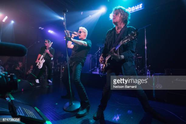 Robert DeLeo Jeff Gutt and Dean DeLeo of Stone Temple Pilots performs onstage during SiriusXM Presents Stone Temple Pilots Live from the Troubadour...