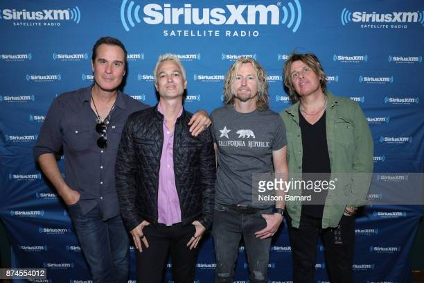 Robert DeLeo Jeff Gutt Eric Kretz and Dean DeLeo of Stone Temple Pilots pose backstage during SiriusXM Presents Stone Temple Pilots Live from the...