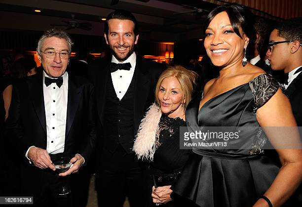 Robert DeNiro Bradley Cooper Gloria Cooper and Grace Hightower attend the 2013 Vanity Fair Oscar Party hosted by Graydon Carter at Sunset Tower on...