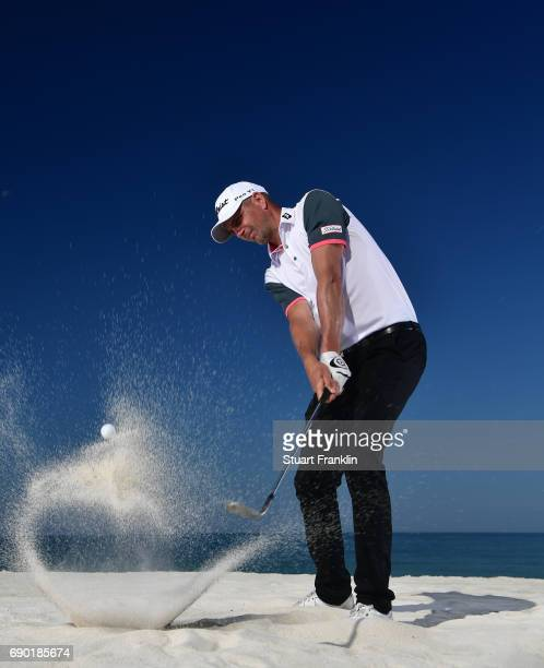Robert Dinwiddie of England plays a shot on the beach prior to the start of The Rocco Forte Open at Verdura Golf and Spa Resort on May 16 2017 in...