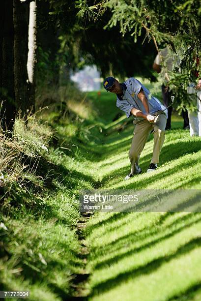 Robert Dinwiddie of the Great Britain Ireland team plays the second shot on the 11th hole from a ditch during the Foursomes matches of the St Andrews...