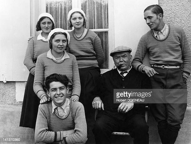 Robert Doisneau in front his half brother standing behind his grandfather Lang his cousins Marthe and Yvonne and Raymonde Goby who will presents him...