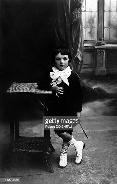 Robert Doisneau portrayed during his childhood circa 1918 France