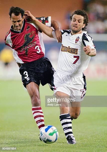 Robert Donadoni of the MetroStars is challenged by Ed Puskarich of Dallas Burn during a match on October 7 1996 in the United Sates