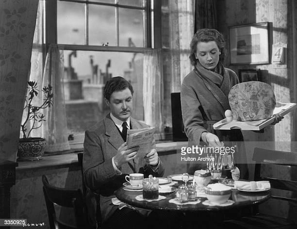 Robert Donat and Deborah Kerr have breakfast in the film 'Perfect Strangers' directed by Alexander Korda for London Films