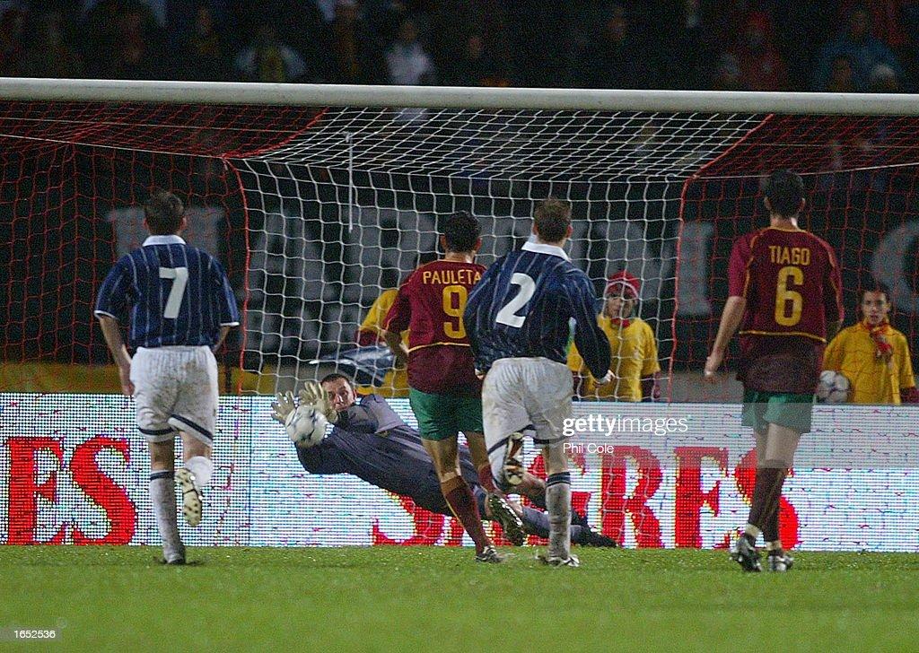 Robert Douglas of Scotland makes a penalty save from Luis Figo : News Photo