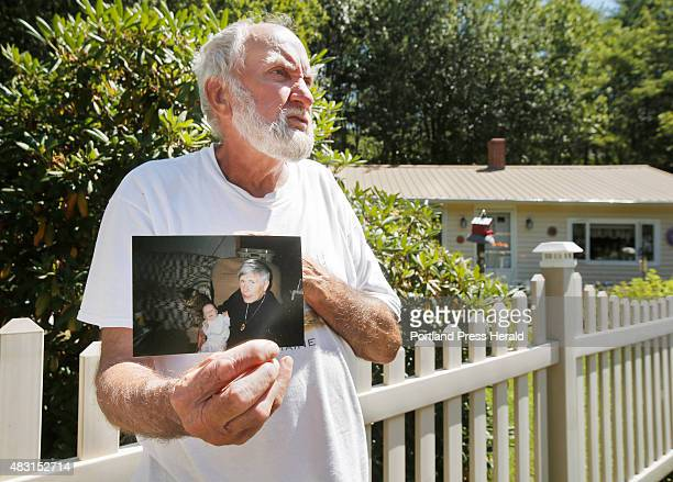 Robert Douglas shows a photo of his wife Rita holding their granddaughter Harley in this family photo taken 17 years ago. Rita Douglas was killed on...