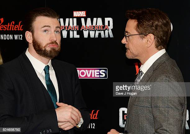 Robert Downey Jr and Chris Evans on stage during the European film premiere of Captain America Civil War at Vue Westfield on April 26 2016 in London...