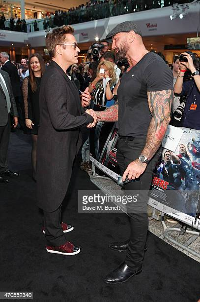 Robert Downey Jr and Dave Bautista attend the European premiere of The Avengers Age Of Ultron at Westfield London on April 21 2015 in London England