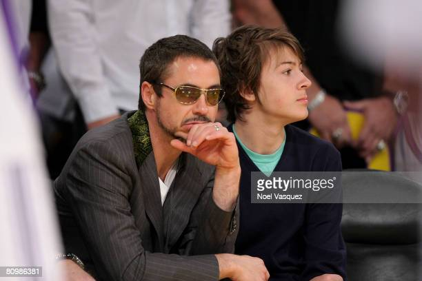 Robert Downey Jr and his son Indio attend the Los Angeles Lakers vs Utah Jazz playoff game at the Staples Center on May 4 2008 in Los Angeles...