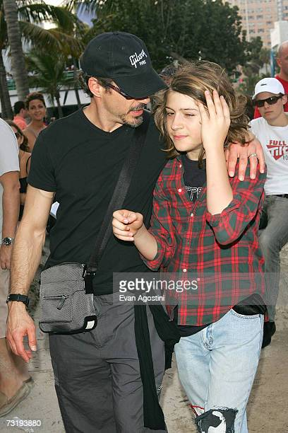 Robert Downey Jr and his son Indio Falconer Downey walk outside the Sprint Style Villa on February3 2007 in Miami Beach Florida