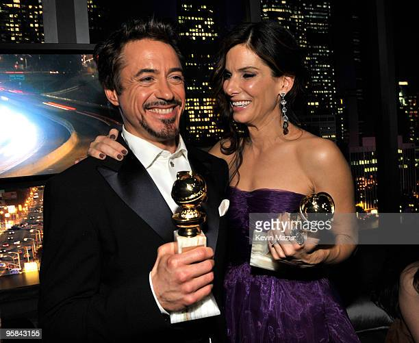 Robert Downey Jr and Sandra Bullock attends the InStyle and Warner Bros 67th Annual Golden Globes postparty held at the Oasis Courtyard at The...