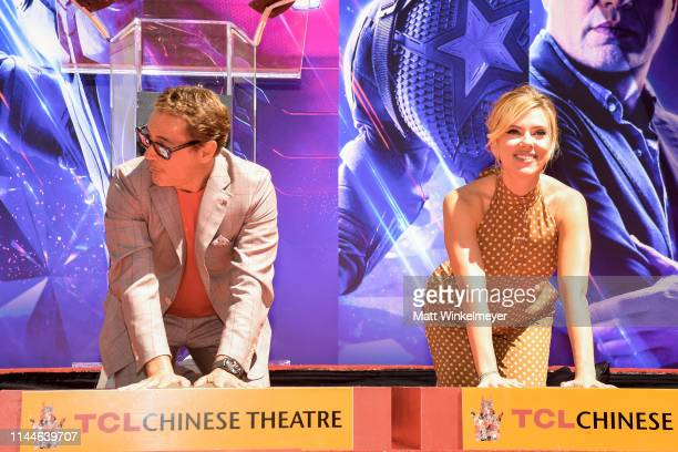 Robert Downey Jr and Scarlett Johansson pose at the Marvel Studios' 'Avengers Endgame' Cast Place Their Hand Prints In Cement At TCL Chinese Theatre...