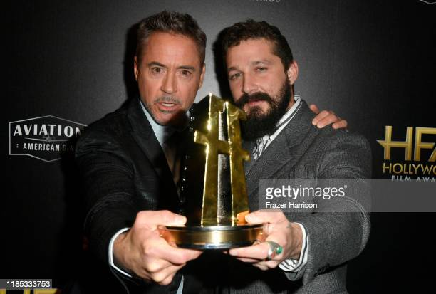 Robert Downey Jr and Shia LaBeouf winner of the Hollywood Breakthrough Screenwriter Award pose in the press room during the 23rd Annual Hollywood...
