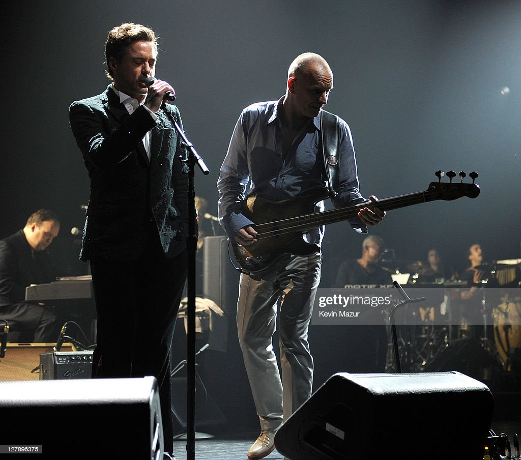 Robert Downey Jr and Sting perform on stage during