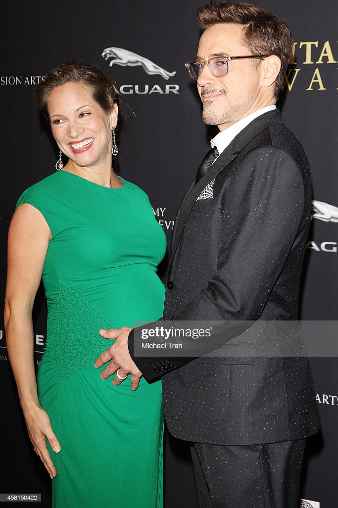 Robert Downey Jr. and Susan Downey arrive at the BAFTA Los Angeles Jaguar Britannia Awards held at The Beverly Hilton Hotel on October 30, 2014 in Beverly Hills, California.
