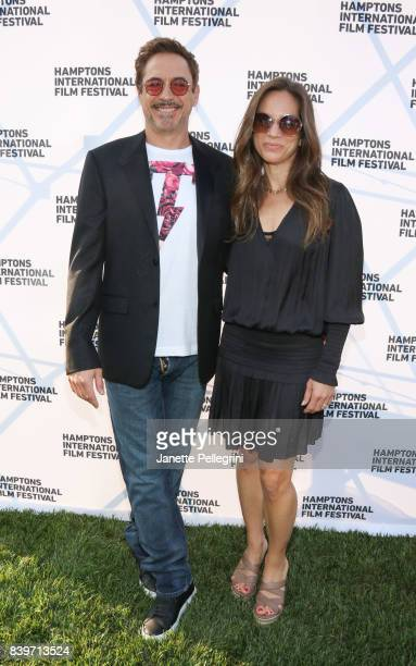 Robert Downey Jr and Susan Downey attend the Hamptons International Film Festival SummerDocs Series Screening of ICARUS on August 26 2017 in East...