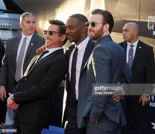 Robert Downey Jr Anthony Mackie and Chris Evans arrive at the premiere of Marvel's 'Captain America Civil War' on April 12 2016 in Hollywood...