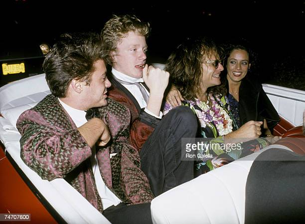 Robert Downey Jr Anthony Michael Hall David Lee Roth and Sonia Braga at the Hard Rock Cafe in New York City New York