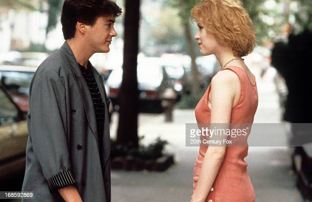 Robert Downey Jr approaches Molly Ringwald in a scene from the film 'The PickUp Artist' 1987