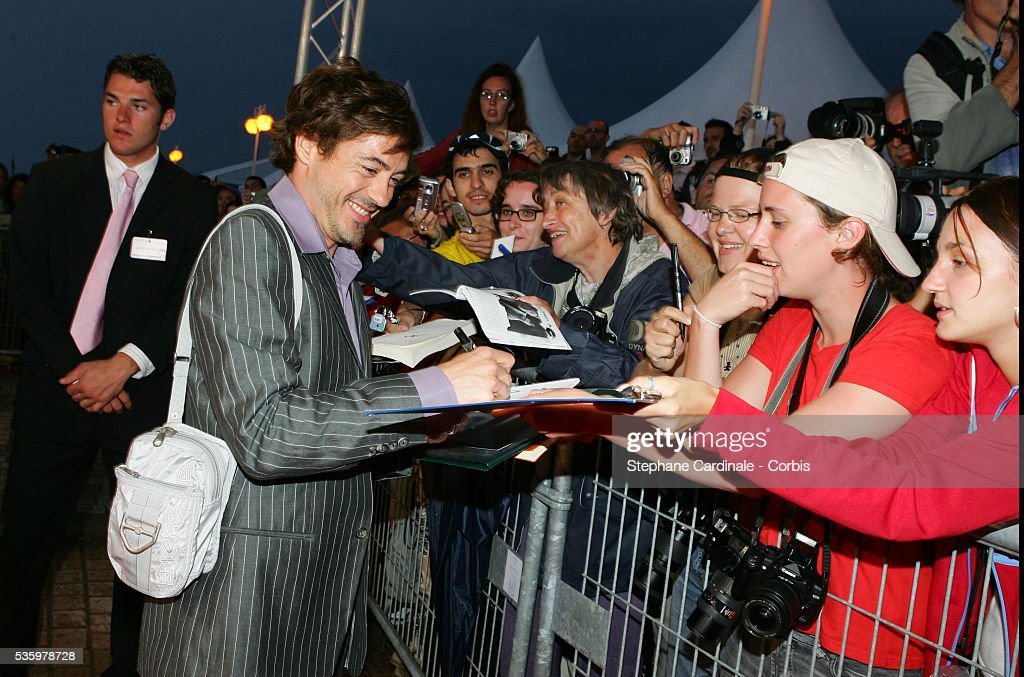 Robert Downey Jr arrives and signs autograph at the premiere of 'Kiss Kiss Bang Bang' during the 31st American Deauville Film Festival.